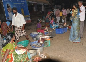 Women selling fish with candles
